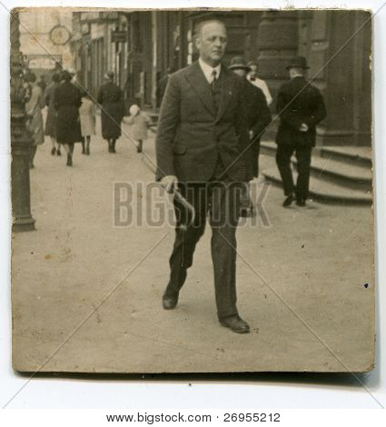 Vintage photo of man walking in the street (twenties/thirties)