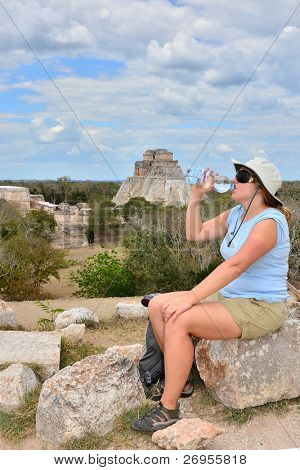 Tourist drinking water in Uxmal, Mexico - Mayan ruins (Pyramid of Magician)