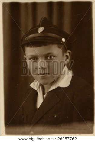 Vintage photo of schoolboy in uniform (twenties)