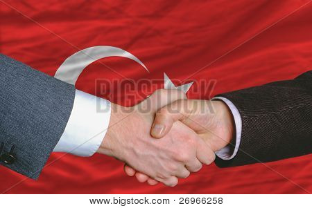 Businessmen Handshake After Good Deal In Front Of Turkey Flag