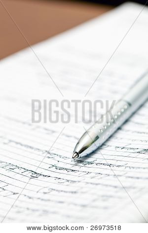 Silver pen lying on a notebook in the office