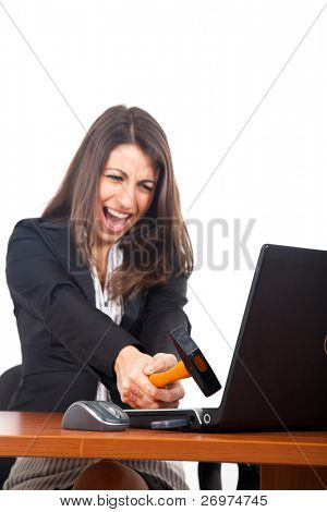 Businesswoman crashing her laptop with a hammer, isolated over white