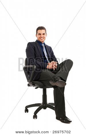 Portrait of smart young male executive sitting on chair isolated on white