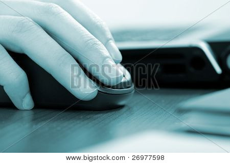 Businesswoman working with her laptop - blue toned image
