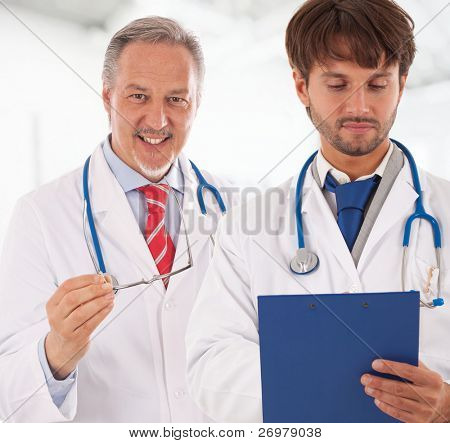 Portrait of an experienced doctor explaining something