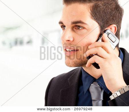 Young executive talking at phone