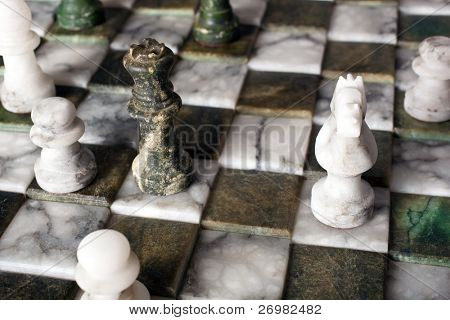 Chess pieces on a marble board