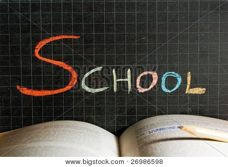 Word School written on a blackboard. Education concept