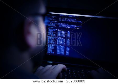 Hacker In Glasses Breaking Code