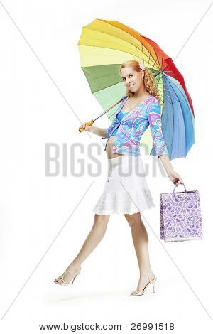 The image of a beautiful pregnant girl with a rainbow umbrella