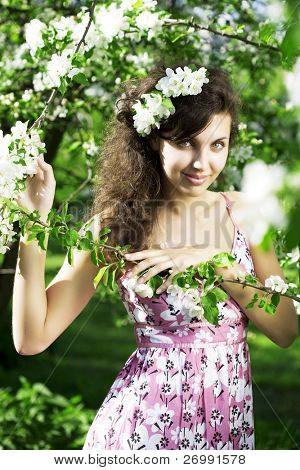 The image of a beautiful girl was blossoming apple orchard