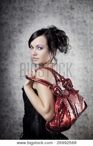 Image of a luxury  woman with bag