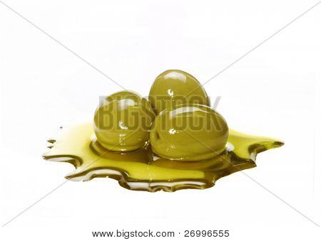 Olive oil and olives. Olive oil on white background.