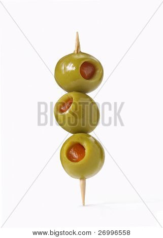 3 olives on a toothpick. Three olives on white background.