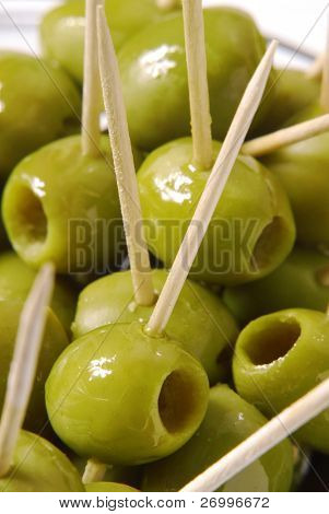 Couple olives in a plate.Punctured olives.