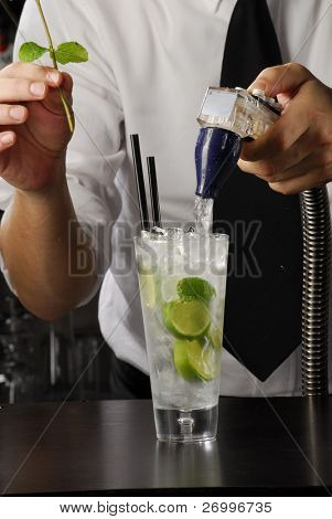 Hands, pouring a cocktail. Bartender pouring liquor, Barman pouring a drink. Bartender preparing a drink.
