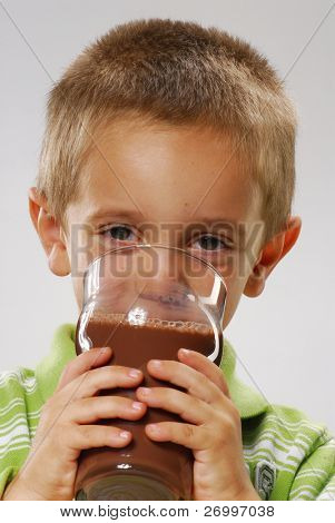 Little boy drinking chocolate drink,boy drinking milk,