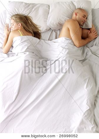 Latin american couple on bed.