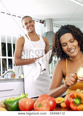 Afro american couple in a kitchen.   Latin couple cooking.