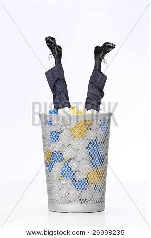 Man with feet up inside an office wastebasket.