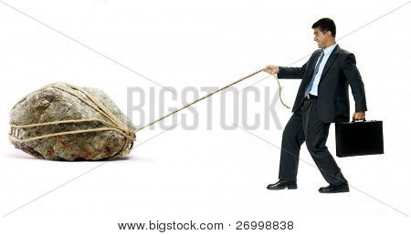 Businessman pulling a big white hanging a black suitcase.