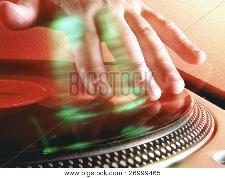 Working Disc jockey at party. Detail of a dj hands.