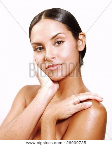 Beautiful young latin woman on white background. Closeup portrait of young beautiful woman after bath - spa