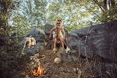 Caveman, Manly Boy At The Fire. Scary Young Primitive Boy Outdoors Near Bonfire. Witch Craft Concept poster