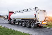 Fuel Truck Waiting In Line For Unloading At A Fuel Automobile Refueling. poster