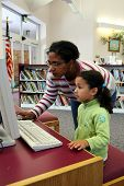 pic of storytime  - Child in a school library with teacher - JPG