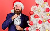 Keep Track Of Time. Time To Celebrate. Man Bearded Wear Suit And Santa Hat Hold Clock. Businessman J poster