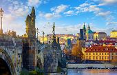 Prague, Czech Republic. Charles Bridge view at old town above river Vltava. Antique statues medieval poster