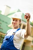 stock photo of locksmith  - builder manager delivering the house - JPG