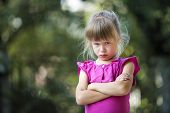 Portrait Of Pretty Funny Moody Young Blond Child Girl In Pink Sleeveless Dress Looks In Camera Feeli poster