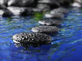 picture of massage therapy  - zen stones in the water - JPG