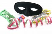 pic of mardi-gras  - holidays and party time paper streamers party blower and black mask isolated on white background - JPG