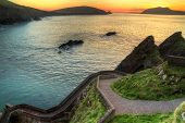 Sunset over pathway leading to Dunquin Pier on Dingle Peninsula, Co.Kerry, Ireland - HDR