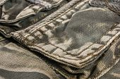 Clothing Items Washed Cotton Fabric Texture With Seams, Clasps, Buttons And Rivets poster