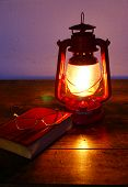 Reading at paraffin lamp light