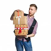 Isolate Man Holding A Box Of Christmas Gifts In His Hands On Sale. The Father Gives Family Gifts. Ch poster