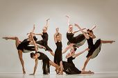 The Group Of Modern Ballet Dancers Dancing On Gray Studio Background poster