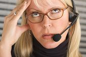 Businesswoman With Phone Headset Has Headache poster