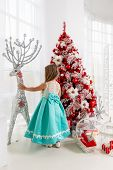 Young Princess In A Smart Dress At Christmas Near A Christmas Tree.little Girl And Christmas Decorat poster