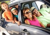 stock photo of family vacations  - Hispanic family in a car.