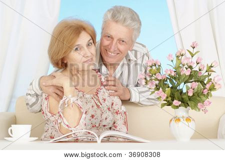 Beautiful elderly couple resting at home