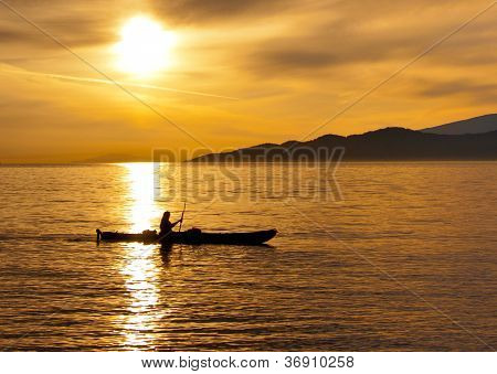 Golden Sunset Kayak Silhouette