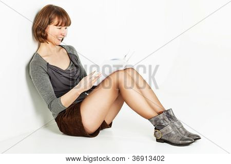 Woman Sitting On The Floor With Book