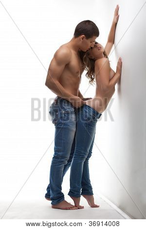 Athletic beauty man and sexy girl posing topless
