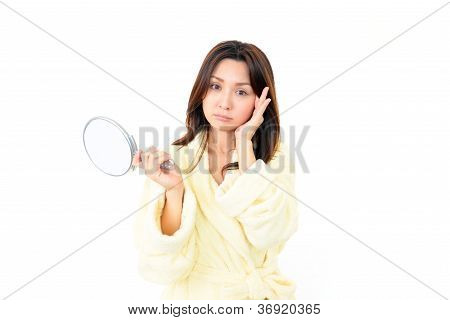 Portrait of a young woman looking depressed