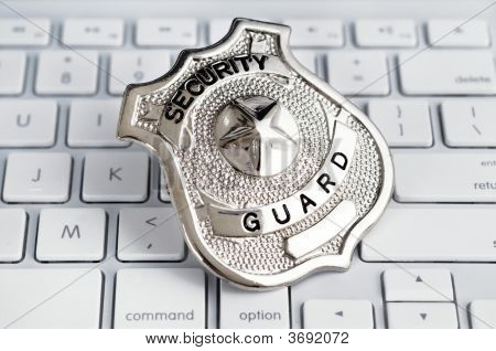 Security Guard Badge Laying On Computer